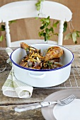Braised chicken with plums, almonds and rosemary and a honey and orange glaze