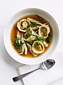 Brodo ai tortelli (chicken broth with tortellini and artichokes)
