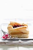 A puff pastry slice filled with marzipan and blueberries