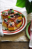 Bocconcini di polenta (polenta slices topped with tomatoes, Italy)