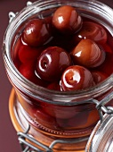 A jar of bottled cherries