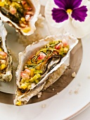 Oysters with tomatoes, shallots, garlic and basil