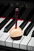 A macaroon on a piano