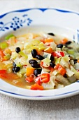 Vegetable stew with peppers, leek and black beans