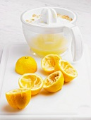 Juiced lemons and a lemon juicer