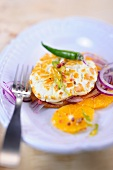 Goats cheese on an orange and onion salad