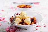 Ricotta dumplings with plum compote
