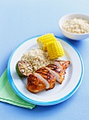 Chilli chicken with rice and corn cobs