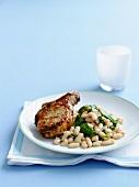 Glazed pork chop with a bean salad