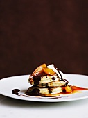 Pikelets with peaches, cream and chocolate sauce