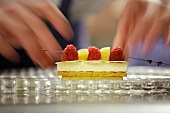 A cream slice and a fruit kebab