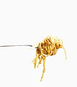 A fork of spaghetti with pesto and grated cheese