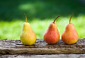 Three pears on a wooden board