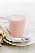A glass of strawberry milkshake