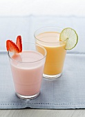 A strawberry milkshake and a mango lassi (mango yogurt drink)