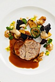 Glazed veal roulade with mushrooms and chard roulade