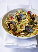 Linguine with mussels, spring onions and chilli peppers