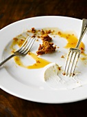The remains of sticky toffee pudding on a plate