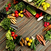 Assorted Fresh Fruits and Vegetables on Wooden Slats