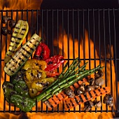Assorted Grilled Vegetables in Grill Rack Above Flames