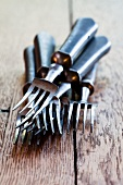 Forks on a wooden surface