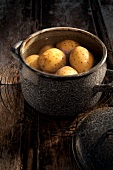 Unpeeled potatoes in a pot of water
