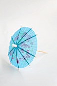 A blue cocktail umbrella