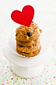 A stack of raisin biscuits decorated with a heart for Valentine's Day