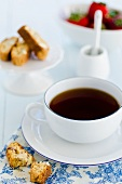 A cup of coffee, cantuccini and strawberries