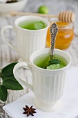 Cold mint tea with honey and limes (Dominican Republic)