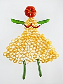 A woman made out of pasta and vegetables