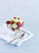 Melon balls with raspberries