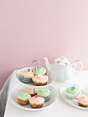 Pistachio and raspberry cupcakes on a cake stand for teatime