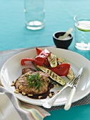 Pork escalope with balsamic vinegar and pine nuts