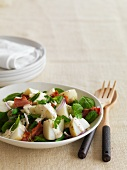 Potato salad with bacon and herbs