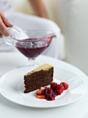 Chocolate cake with berry sauce