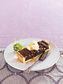 Chocolate and orange pine nut tart