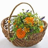 Bouquet of garden flowers in a wicker basket