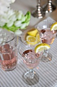 Aperitifs with ice and lemon wedges