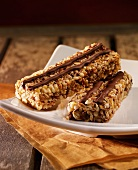 Two muesli bars with chocolate stripes