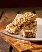 Two muesli bars on a white plate