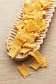 Mafaldine pasta (Reginette pasta) in a wooden dish