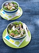 Mixed leaf salad with smoked fish and walnuts