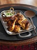 Tandoori chicken on a tray (India)