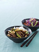 Beef teriyaki with spring onions, cashew nuts and rice