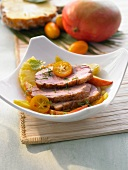 Duck Hawaii with pineapple, mango and kumquats