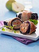 Red cabbage roulade filled with minced meat and wrapped in bacon