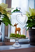 Deer figurine under bell jar as Christmas decorations