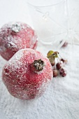 Pomegranates decorated with artificial snow