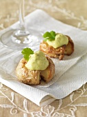 Small baked potatoes topped with avocado creme